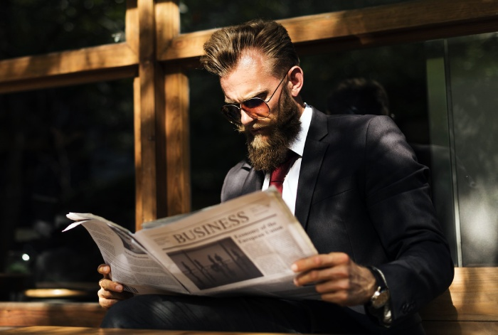 high quality man reading newspaper